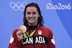 Canada's Kylie Masse poses with her bronze medal on the podium of the Women's Backstroke during the swimming event at the Rio 2016 Olympic Games at the Olympic Aquatics Stadium in Rio de Janeiro on August Olympic Sports, Olympic Team, Olympic Games, Brazil Olympics 2016, Summer Olympics, Kylie, Rio Games, Rio Brazil, Commonwealth Games