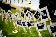 photo escort cards hung on clotheslins