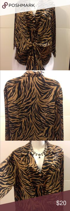 """Jones New York Signature Brand Blouse This is a beautiful, very very gently used blouse. In excellent t condition. The blouse is made of 100% polyester by the Jones New York Signature Brand. It is gold and black with animal print designs. It is a size large with the following measurements: 24"""" sleeve, 28"""" length, 52"""" bust (lots of breast space). This item ships immediately. Jones New York Tops Blouses"""