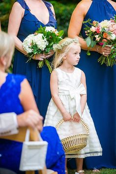 Southern flower girl holding sweet grass basket. - Coordination | Mac & B. Events Photography | Dana Cubbage Weddings