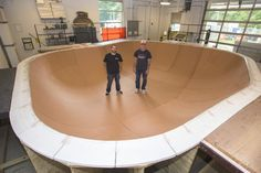 """Ben Ashworth, Sculpture Studio Supervisor, School of Art, (left) and Dave Mutarelli skate in a skate bowl they built at the Fairfax Campus. The bowl is part of a festival at the Kennedy Center called """"Finding a Line."""" The festival will feature live skating demonstrations paired with live jazz performances. Photo by Alexis Glenn."""