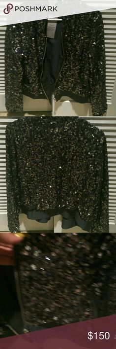 Nwt!! Victoria Secret jacket Victoria Secret  Gudi  Black sequence  jacket Victoria secret New with tags!!! Size 12 women's  Sparkly jacket Bling sparkly sequence Tag on I bought  for 289  Buy 1 item get 1 50% off Until December  5th Victoria's Secret Jackets & Coats