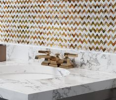 Mother Of Pearl Divine Herringbone Mosaic Tile Backsplash with a Marble Bathroom Countertop for a Chevron Pattern in White and Gold Shell Backsplash, Groutless Tile, Classic Tile, Herringbone Mosaic Tile, Rectified Tile, Chevron Tile, Shell Tiles, Pearl Tile, Tile Installation