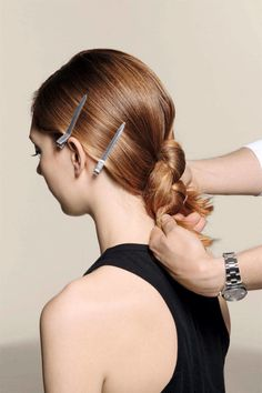 Hide your ends underneath the knot, then bobby pin them and any remaining flyaways into place. Spray (try Kérastase Laque Couture) to add a light hold to your secretly simple yet chic twist.   - ELLE.com