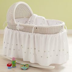 White Baby Bassinet with green bedding