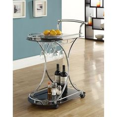 @Overstock - Chrome and tempered glass bar server. Stemware and wine bottle storage make functionality a breeze.  four large castors for ease of movement from room to room. Great modern styling and perfect for all occasions. This is a great space saver.  http://www.overstock.com/Home-Garden/Modern-Bar-Cart/6237582/product.html?CID=214117 $87.08