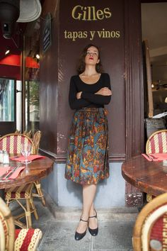 black long-sleeved top, floral midi skirt -- I think I'd change the shoes to something like ballet flats