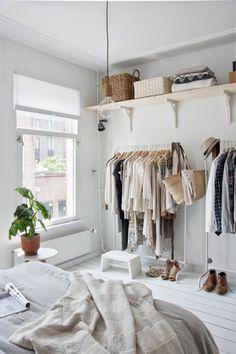 Adding shelves above clothing racks is basically like having a closet without doors. #nocloset #tinycloset More