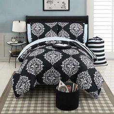 Set includes comforter, 1-2 shams, sheet set, laundry bag, dry erase board, and ottoman.
