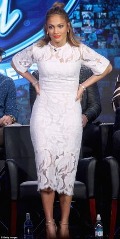 Classic J. Lo:As usual, the 46-year-old wowed in the fashion department, donning a knee length, double-layer white dress with a floral motif