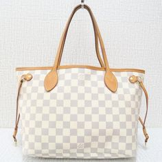 b31f4a3fda4b Get one of the hottest styles of the season! The Louis Vuitton Neverfull  Damier Azur
