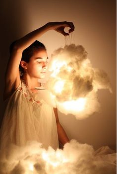 So cute and easy! This dreamy cloud lamp could be for a kids room. Hang some LED lights or a flameless candle and cover it in fluffy stuffing! Imagine a few of these hanging all over the room...This would keep a baby in a crib busy.