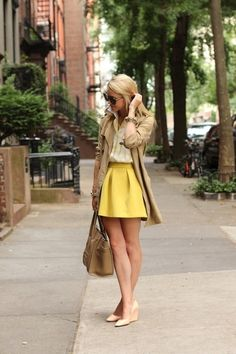 outfit: cream top, yellow wide-pleated miniskirt, beige blazer, cream kitten-wedges, black sunglasses, beige handbag