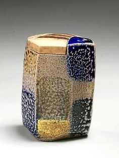AJIKI HIRO (Japanese 1948) Light brown, blue, olive green and gold-glazed faceted checkerboard tea caddy, 2012 Glazed stoneware and wood 3 1/4 x 2 1/2 x 2 1/2 in.