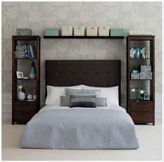I love the use of tall book shelves and how they frame the bed...very cool, i am now inspired to do this look with our new romantic bedroom!