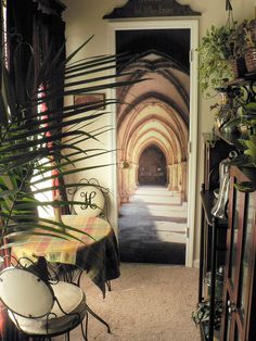 Cafe Hogwarts--my tiny apt. dining area transformed by trompe l'oeil vinyl sticker on closet door!  (Actual corridor at Christ Church College, Oxford University...)