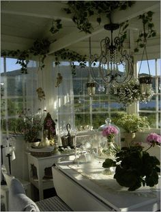 #ShabbyChic #kitchen inspiration - love the plants exposed beams crystal chandelier bell jar with pink flowers all the windows. Beautiful!