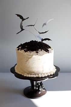 Halloween bat cake. love the flying bats on wire idea. couuld do it with birds too