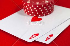 playing with aces - Poker player placing a bet on a pair of aces.
