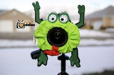 Shutter Buddies lens prop with a squeaker inside - great for photographing small children!  Wouldn't be a difficult DIY project!