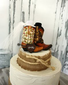 His and hers western boots-wedding cake topper