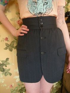 Reconstructed men's suit jacket into a skirt. Just a picture of a skirt for sale - no tutorial.