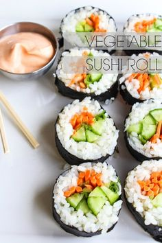 Vegetable Sushi Roll: 1 cup prepared sushi rice; 1 tiny cucumber sliced thin; 4 baby carrots, sliced thin; 1 avocado sliced; 1 scallion, sliced thin lengthwise; 1 sheet of nori. Serve with Spicy Sriracha Sauce.  **