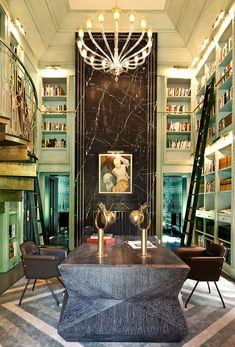 Library by Kelly Wearster + 10 Other Contemporary Art Deco Inspired Interiors // In this Mercer Island library, we again see dominating geometric motifs.  Luxe materials–like marble inset with brass–also impart a sense of Art Deco.  The graceful Murano glass chandelier further channels the kind of grandeur that Daisy Buchanan would live amidst.
