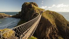 Carrick-a-Rede Rope Bridge - Ireland This famous rope bridge in Ireland connects the mainland to the tiny island of Carrickarede. The original bridge was built over 300 years ago by locals looking to. World Most Beautiful Place, Amazing Places On Earth, World's Most Beautiful, Beautiful Places, Rope Bridge, The North Remembers, Unusual Things, Ireland Travel, Adventure Travel
