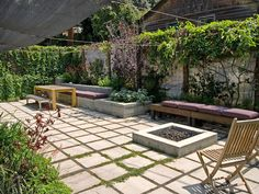 Walled Patio: Raised planting beds, a fire pit, a built-in dining area and a freestanding bench create an outdoor lounge. Photo by Andrew Takeuchi From HGTV.com's Garden Galleries