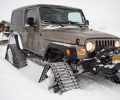 Rubber Wheel Track KitConquer the untamed wild when you charge through the wilderness with the rubber wheel track kit. This track kit substitutes those dinky wheel chains by replacing every wheel with. Jeep Tj, Jeep Rubicon, Jeep Wrangler Tj, Jeep Truck, 4x4 Trucks, Jeep Wagoneer, Lifted Trucks, Cat Exercise Wheel, Cool Jeeps