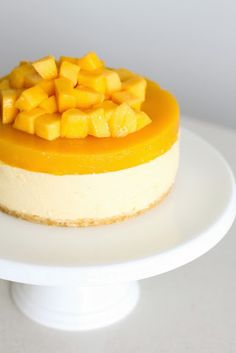 Mango Cheesecake 6 inch cake Base 100g digestive cookies 50g melted unsalted butter Mango cream cheese: 200g pureed mango 200g cream cheese, at room temperature 120ml pouring cream 2 tablespoons milk 10g sheets of leaf gelatine (around 3-4 sheets) 50g greek or plain yogurt juice of half a lemon Mango jelly 150g pureed mango (I used a stick blender to puree) 2 mangoes (1 to place in the gelatine layer and 1 to decorate with on top of cake) 50ml water 10g sugar 1 tablespoon lemon juice 5g…