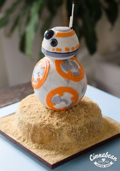 A sculpted cake of the character BB8 from Star Wars: The Force Awakens.