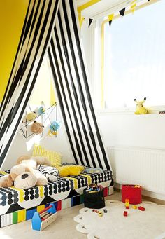 make an open tent over a floor bed for cozy fun every day. love the black and white stripes with a sunshine yellow wall!