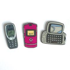 Three phones and ya still ain't shitSoft enamel pin (3 pack)Nokia 3310 - 25.4mm x 10.4mmRazr - 25.4mm x 13.9mmSidekick - 25.0mm x 25.4mm