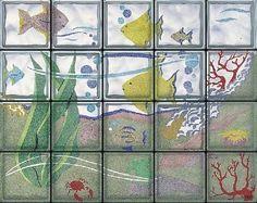 Composición de pavés acuario realizado a mano, en la cual podemos varios peces y corales.