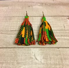 Embrace your Bohemian side with these colorful tassel earrings made with a beautiful African print fabric. This 4-inch pair hang by antique copper earwires.  Copper is a naturally antibacterial metal known to have healing properties  Nickel & Lead free