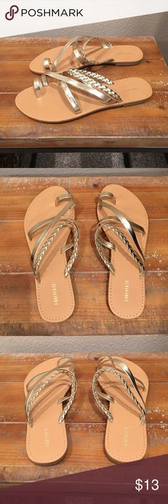 Metallic Gold Sandals NWOT. I bought two pairs of these because that's what I do when I love something❣️ I am selling my backup pair. Great fit. Comfy straps. Love the gold braiding. I wear mine all time tonadd a little spice to cropped jeans or boyfriend shorts. Size 8. True to size however I'm a 7.5 and I can wear them. 💃🏽 Forever 21 Shoes Sandals