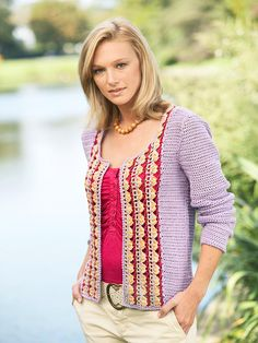 Colorful Scoop-Neck Cardigan    An intricate multicolor pattern details the front of this classic single crochet cardigan. Layer it over a similarly scoop-necked shirt in a coordinating color to make the design stand out.  Get free crochet patterns and instructions for this multi-colored cardigan.