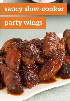 Saucy Slow-Cooker Party Wings -- These slow-cooker BBQ wings, seasoned with honey and OJ, are a crowd-pleaser that make entertaining ridiculously simple.