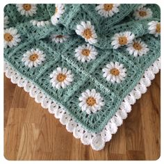 Border Edging pattern by Little Dove Designs. Blanket of Daisies pattern by Tillie Tulip. Photo tutorial for starting the daisy here http://tillietulip.blogspot.com/2012/06/to-beg-chain-ch-5-and-join-to-form.html Photo tutorial for adding rounds to the daisy here http://tillietulip.blogspot.com/2012/06/adding-rounds-to-daisy.html