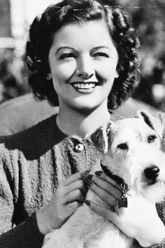 Myrna Loy with..surprise...a wire fox terrier! Could it be Asta?