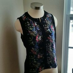NICOLE MILLER....GORGEOUS TUNIC BLOUSE.. ...EXCELLENT CONDITION ... ...LIKE NEW  ...NO FLAWS  ...GORGEOUS  ...true to its size and color ...tunic top blouse ...sheer ...see Tru ...flower design ...multiple colors ...button down top ...hi-lo ...top ...short on front ...back of top is long.. ...MTRL..100%polyester. . ...better in person Nicole by Nicole Miller Tops Blouses
