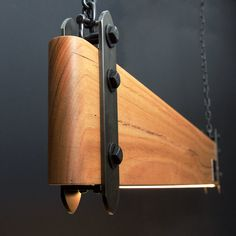 Our industrial linear wood beam LED pendant light is an old-worldly composition of timber and steel contrasted with the clean modern look of embedded LED strip lighting. Linear Lighting, Lighting Design, Lustre Metal, Led Pendant Lights, Wood Pendant Light, Wood Beams, Home Interior, Chandeliers, Wood Projects