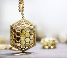 """Starting at $1,400, the Gumuchian """"B"""" Collection combines glamour, whimsy and wearability at an accessible price point (especially considering its worthy cause). Most of the pieces include a modern hexagonal or honeycombed design."""