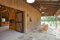 Wood Barn with Open Sitting Porch - Beautiful stone work  www.texastimberframes.com https://www.facebook.com/pages/Texas-Timber-Frames/72503484999