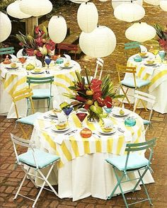 Luau ideas! --I like the paper lanterns, all the same color different sizes.