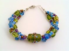 Apple green, light blue and Amethyst multi strand bracelet, with light blue and purple accent Amethyst beads