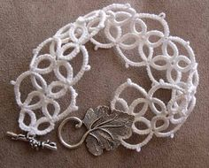 White Tatted Bracelet with Leaf Clasp. $15.00, via Etsy.