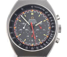 The watch features a gray dial with red and white luminous hands and index luminous hour markers. The edge of the dial displays a red rim with orange hour markers along the edge as well. The watch also features a tachymetre around the outer rim with subsidiary dials for 60 second, 30 minute, and 12 hour. | eBay!